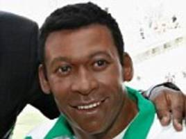 Pele meets.... Pele? Brazilian legend gets up close and personal with new look waxwork